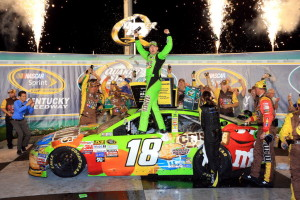 SPARTA, KY - JULY 11:  Kyle Busch, driver of the #18 M&M's Crispy Toyota, celebrates in Victory Lane after winning the NASCAR Sprint Cup Series Quaker State 400 presented by Advance Auto Parts at Kentucky Speedway on July 11, 2015 in Sparta, Kentucky.  (Photo by Daniel Shirey/Getty Images)
