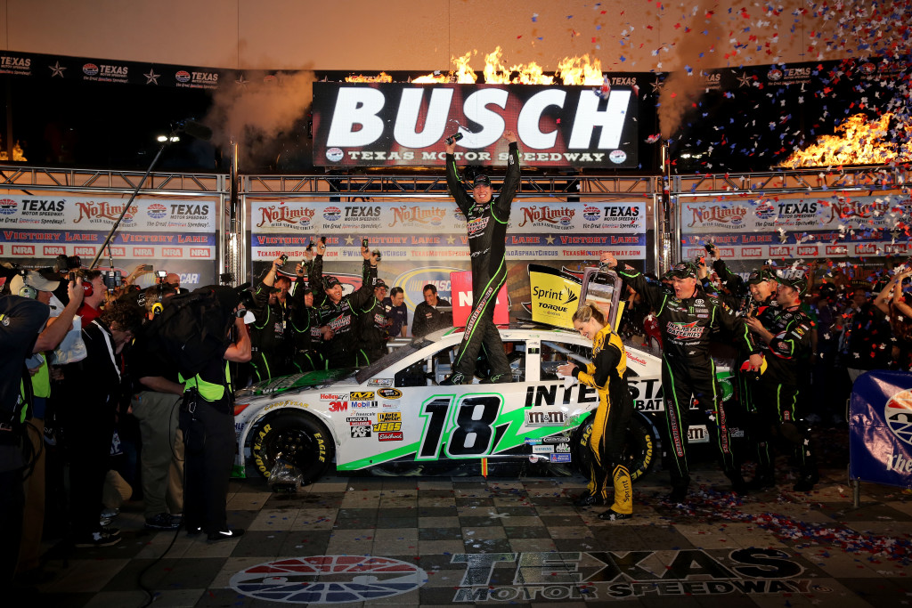 FORT WORTH, TX - APRIL 13:  Kyle Busch, driver of the #18 Interstate Batteries Toyota, celebrates in Victory Lane after winning the NASCAR Sprint Cup Series NRA 500 at Texas Motor Speedway on April 13, 2013 in Fort Worth, Texas.  (Photo by Jerry Markland/Getty Images for Texs Motor Speedway)